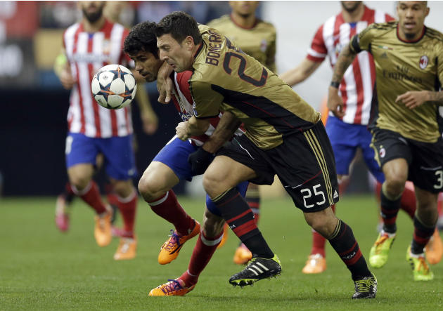 Atletico's Diego Costa, left, and AC Milan's Daniele Bonera vie for the ball, during a Champions League, round of 16, second leg, soccer match between Atletico Madrid and AC Milan at the Vicen