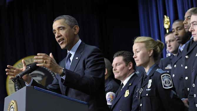 President Barack Obama, accompanied by first responders behind him, gestures as he speaks in the South Court Auditorium of the Eisenhower Executive Office building on the White House complex in Washington, Tuesday, Feb. 19, 2013, to urge Congress to come up with an alternative plan to avert automatic spending cuts set to kick in on March 1, 2013. (AP Photo/Susan Walsh)