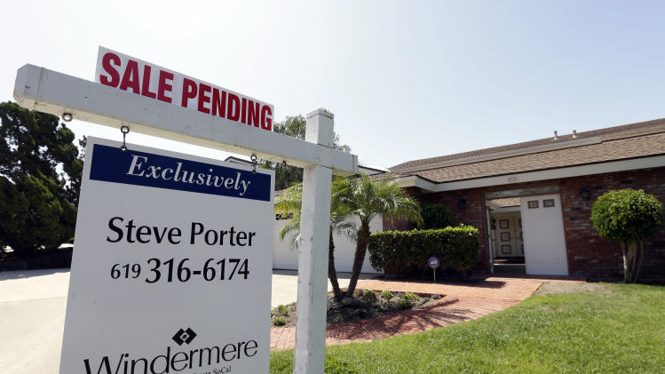 FILE - In this Wednesday, Aug. 14, 2013, file photo, a home is for sale in San Diego. Freddie Mac reports on mortgage rates for the second week of Sepetmber on Thursday, Sept. 12, 2013. (AP Photo/Gregory Bull, File)