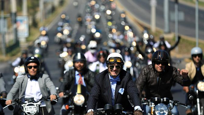 """People ride motorcycles during """"The Distinguished Gentleman's Ride"""" vintage motorcycles race, as part of a campaign to raise awareness on prostate cancer, in Santiago, Chile"""