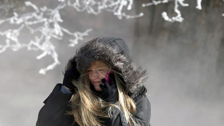 University of Wisconsin-Madison student Marisa Weich contends with sub-zero wind chill temperatures while making her way to class on the campus Tuesday, Jan. 22, 2013. (AP Photo/Wisconsin State Journal, John Hart)