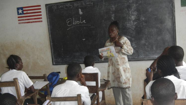 A teacher speaks about the Ebola virus to students in Foya, Liberia in this undated handout photo