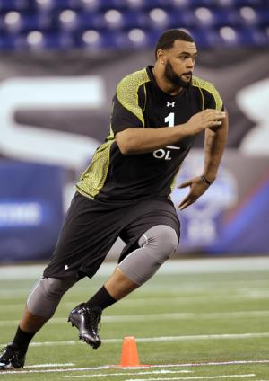 FOR USE AS DESIRED WITH NFL DRAFT STORIES - FILE - In this Feb. 25, 2012, file photo, Ohio State offensive lineman Mike Adams runs a drill at the NFL football scouting combine in Indianapolis. Adams is a top prospect in the upcoming NFL football draft. (AP Photo/Michael Conroy, File)