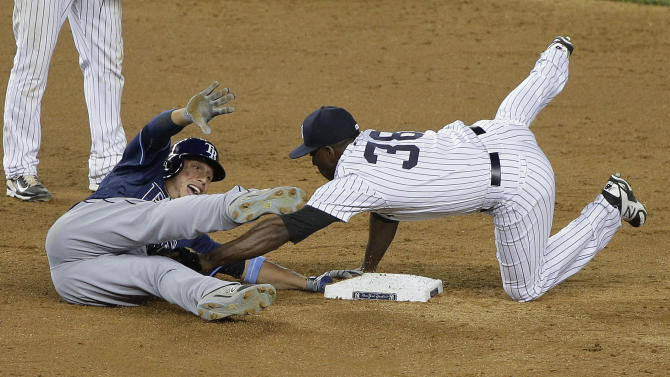 New York Yankees second baseman Jose Pirela (38) puts the tag on Tampa Bay Rays' Asdrubal Cabrera, who tried to stretch a hit into a double during the ninth inning of a baseball game, Friday, July 3, 2015, in New York. The Yankees won 7-5 in 12 innings. (AP Photo/Julie Jacobson)
