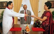President Mahinda Rajapakse (L) presents a letter of appointment to Shirani Bandaranayake who became Sri Lanka's first woman chief justice in May 2011. Sri Lanka's ruling party lawmakers have submitted a parliamentary motion to impeach Bandaranayake