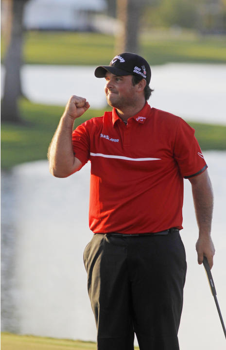 Patrick Reed pumps his fist after winning the Cadillac Championship golf tournament Sunday, March 9, 2014, in Doral, Fla. (AP Photo/Marta Lavandier)