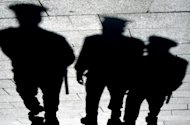 The shadows of policemen fall on the pavement as they patrol in Kiev, 2004. An 18-year old Ukrainian girl died almost three weeks after suffering a gang rape attack by youths which has become one of the country's most notorious crimes of recent years