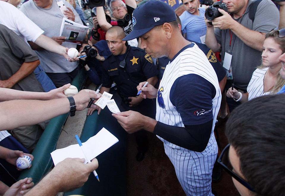 New York Yankees' Alex Rodriguez autographs a ticket stub for a fan before the start of a Class AA baseball game with the Trenton Thunder against the Reading Phillies, Friday, Aug. 2, 2013, in Trenton, N.J. (AP Photo/Tom Mihalek)