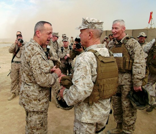 Marine Gen. John Allen, left, the top U.S. and NATO commander in Afghanistan, Gen. James Amos, commandant of the Marine Corps, and Marine Maj. Gen. John Toolan, right, the senior U.S. commander in Helmand Province, confer at Combat Outpost Alcatraz on Thursday, Nov. 23, 2011, on Thanksgiving, just north of Sangin in north-central Helmand Province, Afghanistan. (AP Photos/Robert Burns)