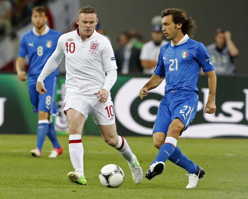 Italy's Andrea Pirlo, right, and England's Wayne Rooney vie for the ball  during the Euro 2012 soccer championship quarterfinal match between England and Italy in Kiev, Ukraine, Sunday, June 24, 2012. (AP Photo/Gregorio Borgia)