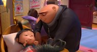 "This film publicity image released by Universal Pictures shows characters Agnes, voiced by Elsie Fisher, left, and Gru, voiced by Steve Carell in ""Despicable Me 2."" (AP Photo/Universal Pictures)"
