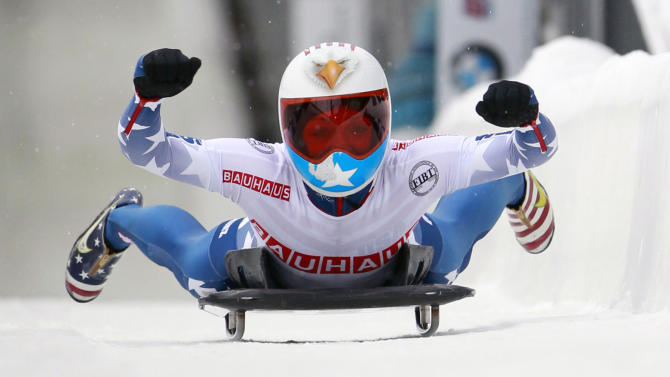 USA's Katie Uhlaender reacts after winning the women's Skeleton World Championships in Lake Placid, N.Y., on Friday, Feb. 24, 2012. (AP Photo/Mike Groll)