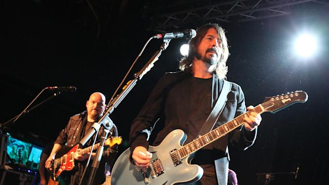 Alain Johannes, left, and Dave Grohl, of the Foo Fighters perform with the Sound City Players at Park City Live Day 2 on Friday, January 18, 2013, in Park City, Utah. (Photo by Barry Brecheisen/Invision for Park City Live/AP Images)