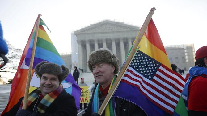 Marcus, left, and Daniel  German-Dominguez stand outside the Supreme Court in Washington, Tuesday, March 26, 2013, before the court's hearing on California's voter approved ban on same-sex marriage. (AP Photo/Pablo Martinez Monsivais)
