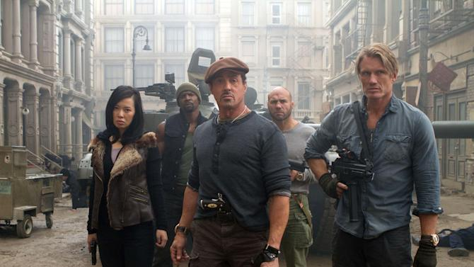 """This film image released by Lionsgate shows, from left, Yu Nan, Terry Crews, Sylvester Stallone, Randy Couture and Dolph Lundgren in a scene from """"The Expendables 2."""" The veteran action stars of """"The Expendables 2"""" say a stuntman's on-set death served as a reminder of the danger behind building big-screen thrills. Stallone, who also co-wrote the script, told reporters this week in London that there had been deaths during two of his previous films and """"it's never easy."""" (AP Photo/Lionsgate-Millennium Films, Frank Masi)"""