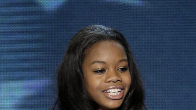 Olympic gold medalist Gabby Douglas recites the Pledge of Allegiance at the Democratic National Convention in Charlotte, N.C., on Wednesday, Sept. 5, 2012. (AP Photo/J. Scott Applewhite)