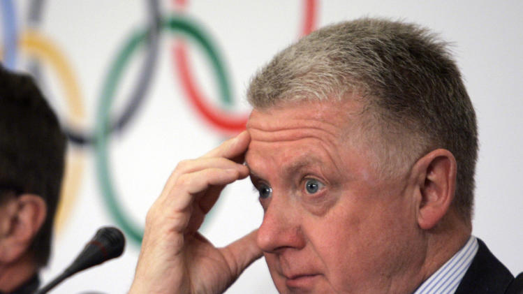 """FILE - In this April 3, 2008 file photo, Hein Verbruggen, coordination commission chairman of the 2008 Beijing Olympic Organizing Committee, listens during a news conference in Beijing. International Cycling Union honorary president Hein Verbruggen says there was no conflict of interest when he invested in a brokerage account later linked to Lance Armstrong's team owner. Verbruggen tells The Associated Press it is """"cynical"""" for U.S. Anti-Doping Agency CEO Travis Tygart to suggest the business relationship """"stinks to high heaven."""" (AP Photo/Robert F. Bukaty, File)"""