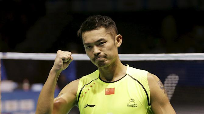 Lin of China celebrates after defeating compatriot Tian during their men's singles final match at the 2015 Badminton Asia Championships, in Wuhan