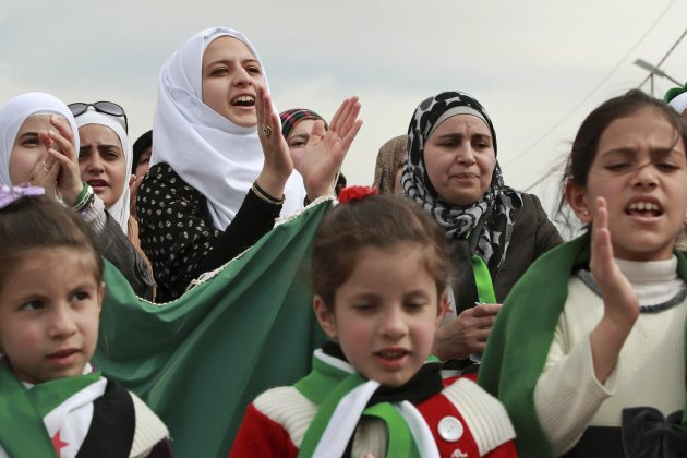 Syrians living in Jordan shout slogans against Syria's President Bashar al-Assad during a protest in front of the Syrian embassy in Amman