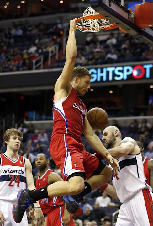 Los Angeles Clippers forward Blake Griffin (32) dunks the ball past Washington Wizards forward Jan Vesely (24), from The Czech Republic, and center Marcin Gortat (4), from Poland, in the first half of