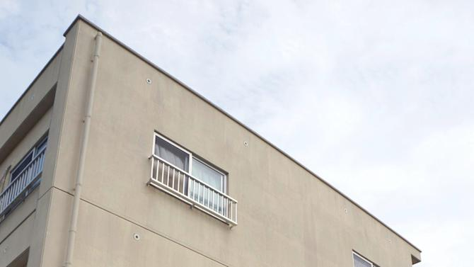 An apartment where authorities say a 24-year-old U.S. airman is suspected of entering and punching a young boy, stands at Chatan, on the island of Okinawa, southern Japan Friday, Nov. 2, 2012. Japan's government is lodging a formal complaint with U.S. officials over reports of another incident involving misbehavior by U.S. troops on the island despite a new curfew imposed after two Navy sailors were arrested for allegedly raping a local woman.  (AP Photo/Kyodo News) JAPAN OUT, MANDATORY CREDIT, NO LICENSING IN CHINA, FRANCE, HONG KONG, JAPAN AND SOUTH KOREA