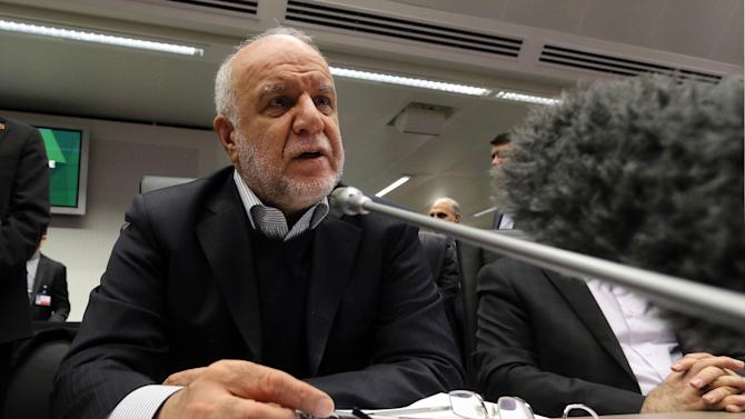Iran's Minister of Petroleum Bijan Namdar Zangeneh speaks to journalists prior to the start of a meeting of the Organization of the Petroleum Exporting Countries, OPEC, at their headquarters in Vienna, Austria, Thursday Nov. 27, 2014. Expectations that the group would not cut output to support the market saw the global price of oil slump another US dollar 1.89 on Thursday to US dollar 75.86 a barrel, extending its losses since June, when it was as high as US dollar 115. (AP Photo/Ronald Zak)