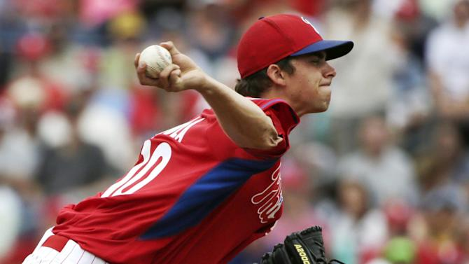 Philadelphia Phillies relief pitcher Aaron Nola winds up in the second inning of a spring training baseball game against the New York Yankees in Clearwater, Fla., Friday, March 27, 2015. (AP Photo/Kathy Willens)
