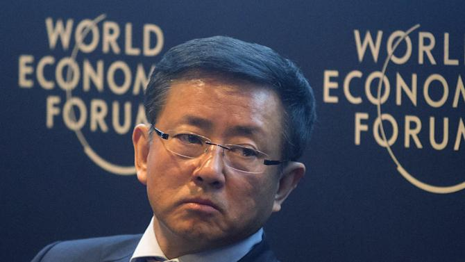 Fan Gang, the director of National Research Institute, China Reform Foundation, listens during the China's Growth Context session of the 43rd Annual Meeting of the World Economic Forum, WEF, in Davos, Switzerland, Wednesday, Jan. 23, 2013. (AP Photo/Michel Euler)