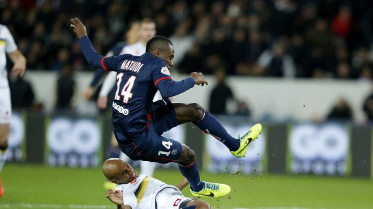 Paris St Germain's Matuidi challenges FC Sochaux's Carlao during their French Ligue 1 soccer match at the Parc des Princes Stadium in Paris