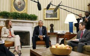 Obama pauses as he talks next to U.S. Secretary of HHS Burwell and Director of the CDC Frieden after meeting with his team coordinating the government's Ebola response in the Oval Office of the White House in Washington