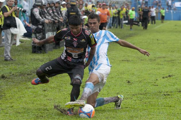 Gaviao of the Gaviao Kyikateje soccer club battles with an opponent from the Paysandu club in Belem