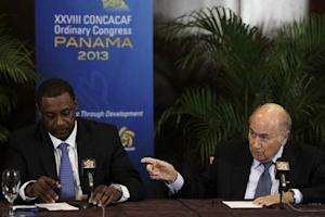 """FIFA President Joseph """"Sepp"""" Blatter gestures next to CONCACAF President Jeffrey Webb during a news conference at the CONCACAF congress in Panama City"""