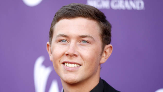 Scotty McCreery arrives at the 47th Annual Academy of Country Music Awards on Sunday, April 1, 2012 in Las Vegas. (AP Photo/Isaac Brekken)