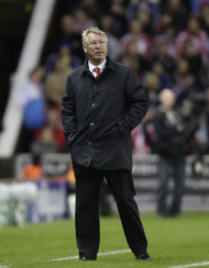 Manchester United's manager Sir Alex Ferguson stands on the touchline during his team's 1-1 draw against Stoke City in their English Premier League soccer match at the Britannia Stadium, Stoke, England, Saturday Sept. 24, 2011. (AP Photo/Jon Super)