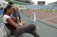 French former Olympic champion Marie-Jose Perec -- then now working as a consultant for a French sports daily -- is pictured joking with journalists on the side of the track of the World Championships in Osaka, Japan on August 23, 2007