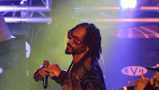 Multi-platinum rapper Snoop Dogg performs during an exclusive live concert at Hard Rock Cafe Las Vegas on The Strip on Saturday, December, 22, 2012 in Las Vegas. (Photo by Jeff Bottari/Invision for Hard Rock Cafe/AP Images)