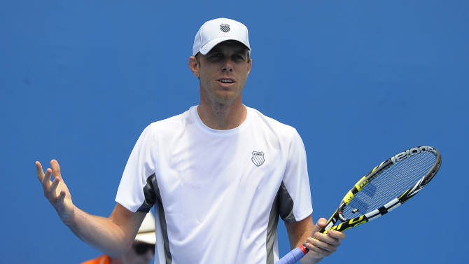 Sam Querrey of the US reacts after losing a point to compatriot Brian Baker during their second round match at the Australian Open tennis championship in Melbourne, Australia, Wednesday, Jan. 16, 2013. (AP Photo/Andrew Brownbill)