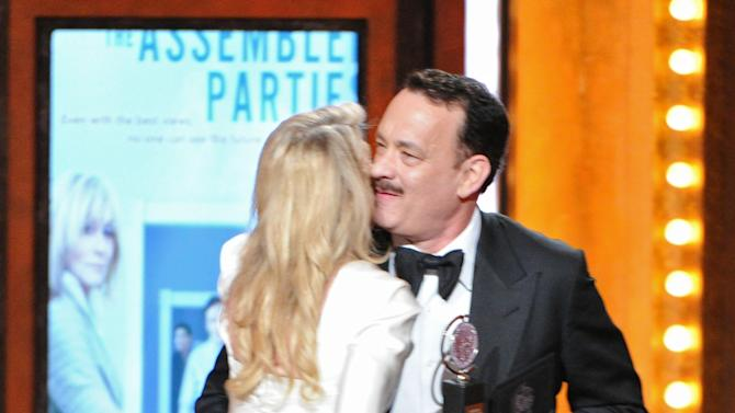 "Actor Tom Hanks presents the Best Performance by an Actress in a Featured Role in a Play award to actress Judith Light for ""The Assembled Parties"" at the 67th Annual Tony Awards, on Sunday, June 9, 2013 in New York.  (Photo by Evan Agostini/Invision/AP)"