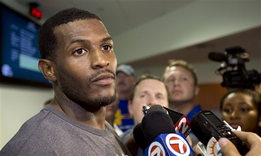 Miami Dolphins' Mike Wallace talks to reporters after the team's NFL football training camp in Davie, Fla. Tuesday, May 21, 2013