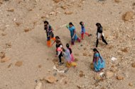 &lt;p&gt;Indian villagers cross a dry river bed in Gandhinagar district. With drought parching farms in the United States and near the Black Sea, weak monsoon rains in India and insidious hunger in Africa&#39;s Sahel region, the world could be headed towards another food crisis, experts say.&lt;/p&gt;