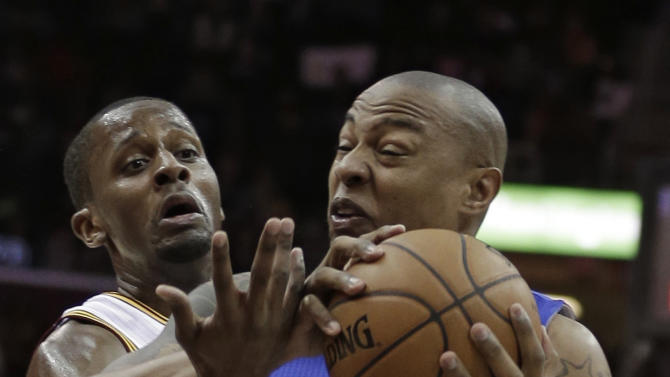 Cleveland Cavaliers' C.J. Miles, left, fouls Los Angeles Clippers' Caron Butler (5) during the second quarter of an NBA basketball game on Friday, March 1, 2013, in Cleveland. (AP Photo/Tony Dejak)