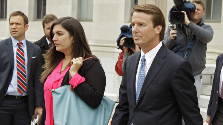 Former presidential candidate and U.S. Sen. John Edwards, right, leaves a federal court with his daughter Cate, left, in Greensboro, N.C., Monday, April 23, 2012. A former aide to Edwards has taken the witness stand in his criminal trial to testify about his role in allegedly violating campaign finance laws to cover up an extramarital affair. (AP Photo/Chuck Burton)