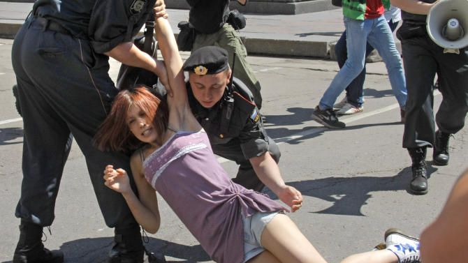 "FILE - In this Saturday, May 28, 2011 file photo Russian police officers detain a gay rights activist during an attempt to hold a gay pride parade in Moscow, Russia. A controversial bill banning ""homosexual propaganda"" has been submitted to Russia's lower house of parliament for the first of three hearings Tuesday, Jan. 22, 2013. (AP Photo/Mikhail Metzel, file)"