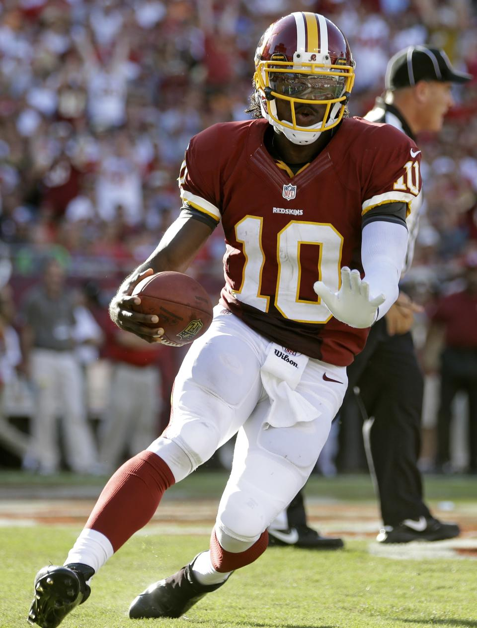 Washington Redskins quarterback Robert Griffin III scores on a five-yard touchdown run against the Tampa Bay Buccaneers during the second quarter of an NFL football game Sunday, Sept. 30, 2012, in Tampa, Fla. (AP Photo/Margaret Bowles)