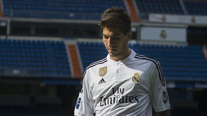 Brazilian international soccer player Lucas Silva, juggles a football during his official presentation at the Santiago Bernabeu stadium in Madrid, Spain, Monday, Jan. 26, 2015, after signing for Real Madrid. (AP Photo/Andres Kudacki)