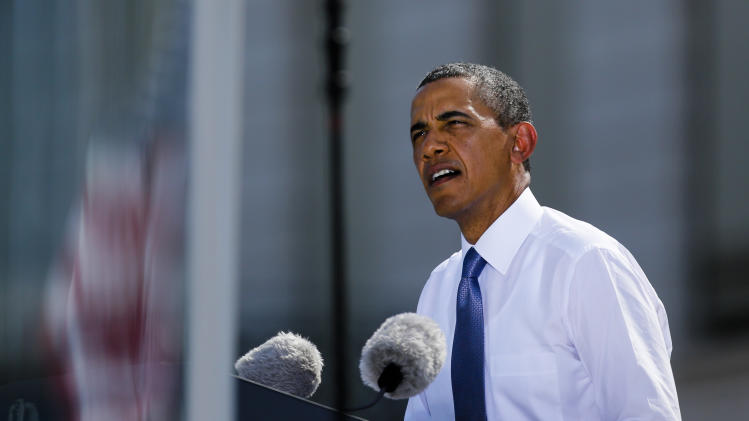 US President Barack Obama delivers a speech in front of Brandenburg Gate in Berlin Wednesday, June 19, 2013. Obama is on a two-day official visit to the German capital. (AP Photo/Markus Schreiber)
