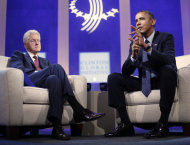 President Barack Obama, right, with former President Bill Clinton, left, speaks at the Clinton Global Initiative in New York, Tuesday, Sept. 24, 2013. (AP Photo/Pablo Martinez Monsivais)