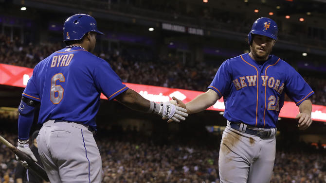 New York Mets' Daniel Murphy, right, is congratulated by Marlon Byrd (6) after scoring against the San Francisco Giants during the sixth inning of a baseball game in San Francisco, Monday, July 8, 2013. (AP Photo/Jeff Chiu)