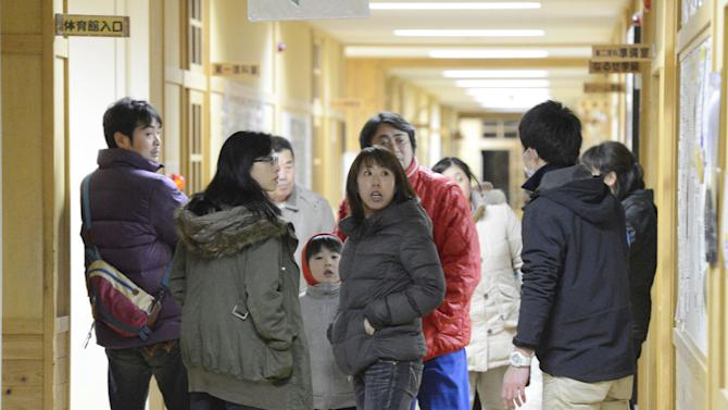 Tsunami evacuees arrive at Takata Junior High School that stands on a higher ground in Rikuzentakata in Iwate Prefecture, Friday, Dec. 7, 2012 after a tsunami warning has been issued following a strong earthquake that struck off the coast of northeastern Japan. It is the same region that was hit by a massive earthquake and tsunami last year. (AP Photo/Kyodo News) JAPAN OUT, MANDATORY CREDIT, NO LICENSING IN CHINA, FRANCE, HONG KONG, JAPAN AND SOUTH KOREA