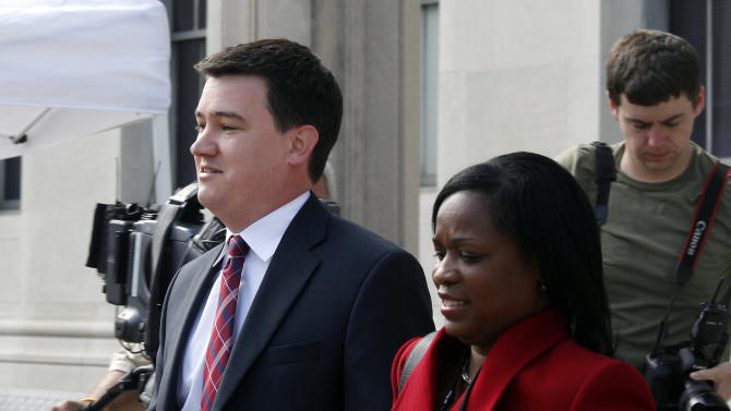 Matthew L. Nelson is escorted from the Federal Courthouse in Greensboro, N.C., Wednesday May 2, 2012 after testifying in the trial of former Sen. John Edwards. Edwards is accused of conspiring to secretly obtain more than $900,000 from two wealthy supporters to hide his extramarital affair with Rielle Hunter and her pregnancy from the media. He has pleaded not guilty to six charges related to violations of campaign-finance laws. (AP Photo/The News & Observer, Chuck Liddy)